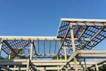Close-up of roof construction home framing against a blue sky Stock Photo