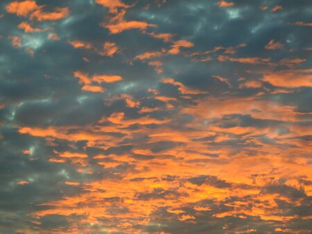 Abstract sunset sky in orange and blue colour. Stock Photo