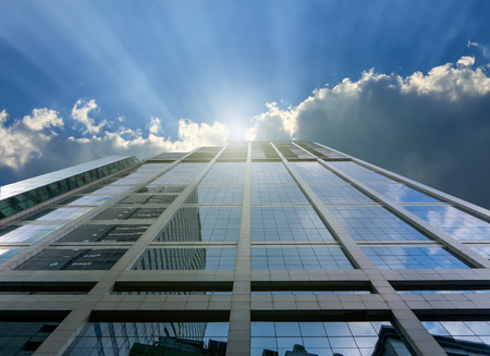 luxury house: Close up of blue modern office building and sunray. Stock Photo