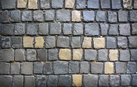 Gray and yellow paving stones. Backgrounds and textures.