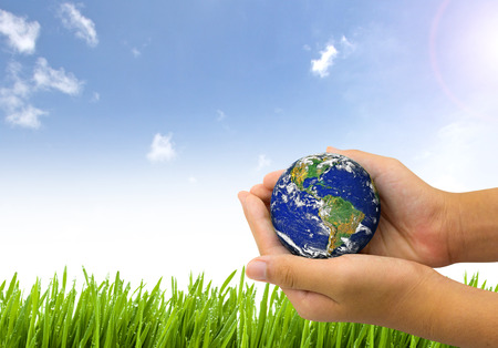 Earth planet the hand on nature and blue sky background - Corporate social responsibility concept. - Elements of this image furnished by NASA Banco de Imagens