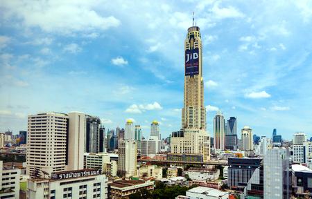 BANGKOK - JULY 21, 2016 : Baiyoke tower with surroundings buildings and clouds at Bangkok city in Thailand.