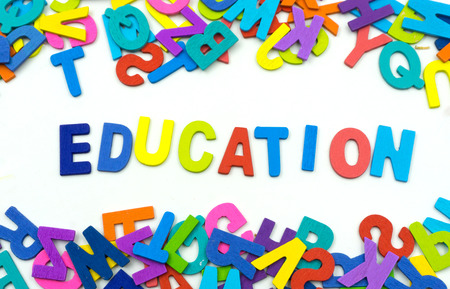 facilitating: The letters made of plywood the words education are on a white background. Education is the process of facilitating learning, and the acquisition of knowledge, skills, values, beliefs, and habits.