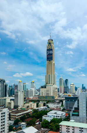 BANGKOK - JULY 21, 2016 : Baiyoke tower with surroundings buildings and clouds at Bangkok city in Thailand.