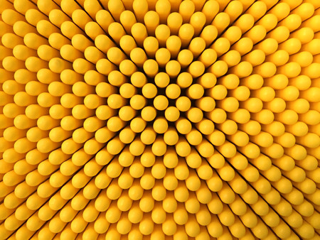 Abstract dots background in yellow colors. Yellow is the color of sunshine. Its associated with joy, happiness, intellect, and energy. produces a warming effect, arouses cheerfulness, stimulates mental activity, and generates muscle energy.  is often ass Banco de Imagens