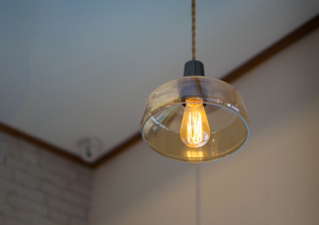 An incandescent light bulb, incandescent lamp or incandescent light globe is an electric light with a wire filament heated to such a high temperature that it glows with visible light (incandescence). Stock Photo