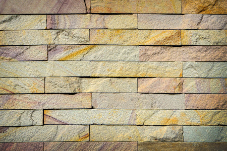 defines: Yellow brick wall texture background, A wall is a structure that defines an area, carries a load, or provides shelter or security. There are many kinds of walls: Stock Photo