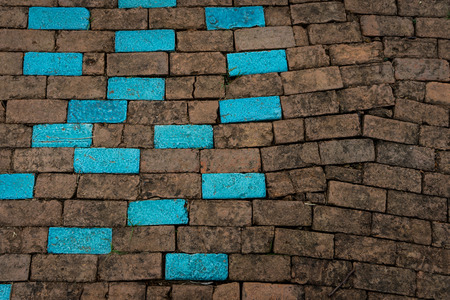 defines: Blue and brown brick wall texture background, A wall is a structure that defines an area, carries a load, or provides shelter or security. There are many kinds of walls: Stock Photo