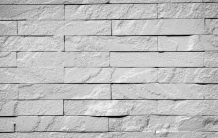 defines: White brick wall texture background, A wall is a structure that defines an area, carries a load, or provides shelter or security. There are many kinds of walls: Stock Photo
