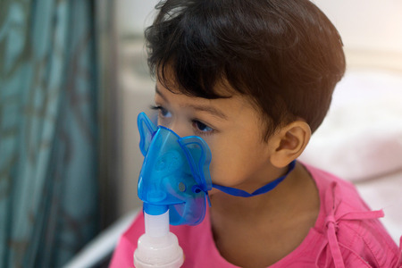 Asian kids boy 3 years old has Sick in nebulizer mask.