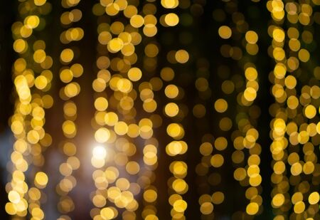 Golden Abstract Blurred Bokeh Glitter Christmas, Xmas Holiday. Stock Photo