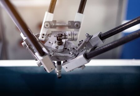 Picture of the details of the industrial machine that is working.