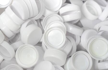 The white plastic lid that is left over from the bottles are collected to be recycled into other items for reuse.