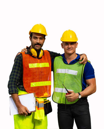 Two male construction workers or engineers stood and hugged each other. Isolated on white background Banque d'images