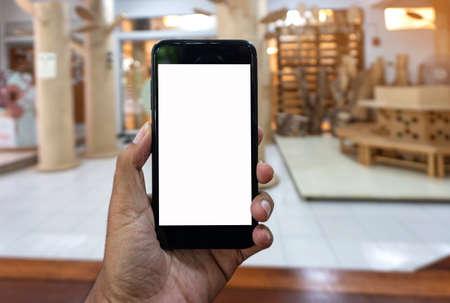 Asian man using hand hold black smartphone, Smartphone mockup background.