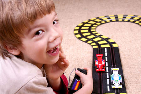 Boy playing with toy car photo