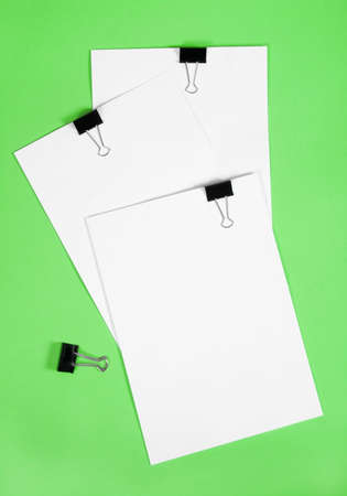 scratch pad: White Note pad against a green background