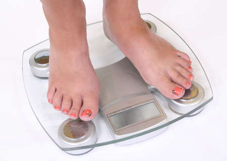Feet on scale close up