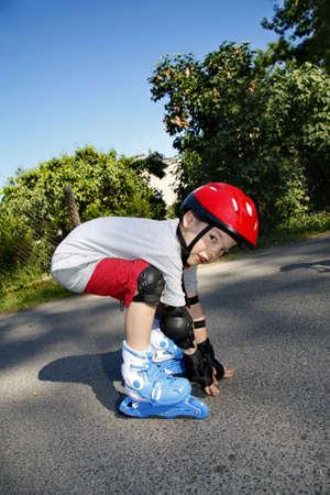 Boy roller - blading photo