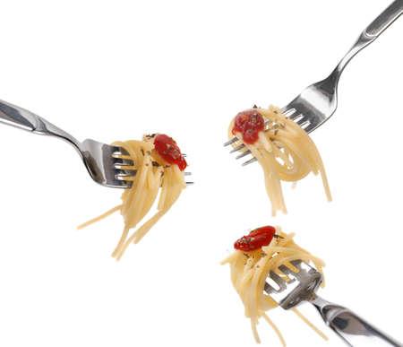 Spaghetti pasta and tomato sauce twirled on a fork. photo