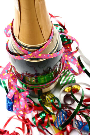 champagne and party time with paper confetti streamers and party blowers Stock Photo
