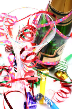 blowers: champagne and party time with paper confetti streamers and party blowers Stock Photo