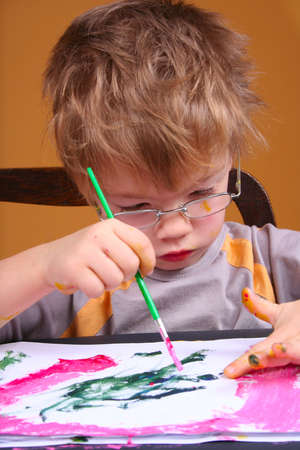 4 year old boy covered in bright paint Stock Photo - 4117695