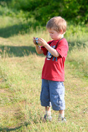 Young boy, photographer, digital camera, one person photo
