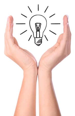 Hand holding drawn light bulb - EcologyEnvironment concept