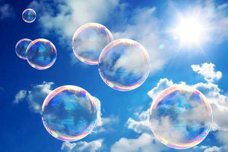 Soap bubbles on blue sky. Beauteful sunny day. Very nice color of the sky. Standard-Bild