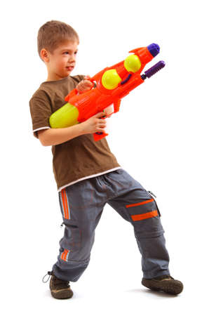 Young boy with water gun over white background. photo