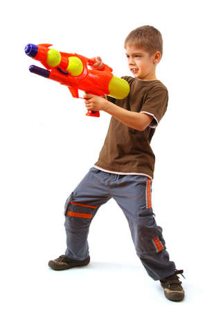 water gun: Young boy with water gun over white background. Stock Photo