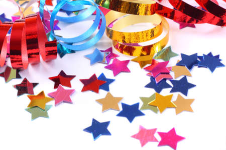 Stars in the form of confetti  with streamers on white Stock Photo