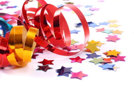 Stars in the form of confetti  with streamers on white photo