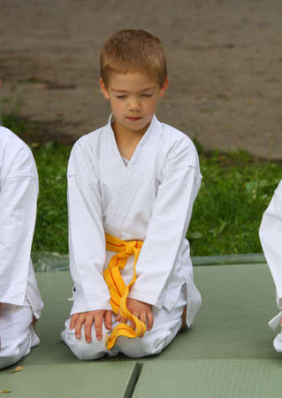 kid in karate suit with yellow belt on competition Stock Photo - 4945889