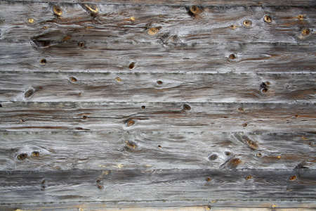 Grungy brown wooden textured background close up photo