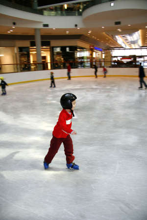Winter time. Young boy learning to skate
