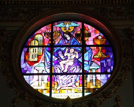 swaddling: Nativity scene in stained glass church window.