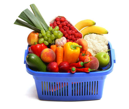 A shopping basket full of fresh produce on white.