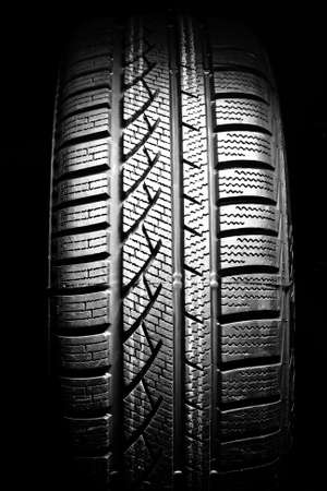 New car tire close up on black background photo