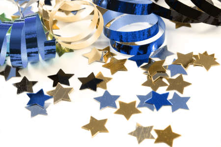 Stars in the form of confetti  with streamers on white Standard-Bild