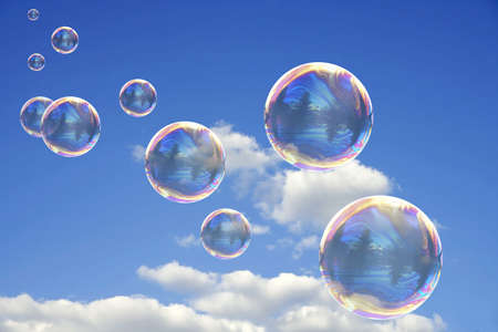Colorful Soap Bubbles Against Blue Sky Background Stock Photo