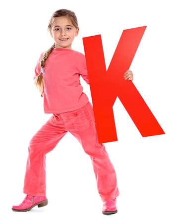 letter k: Girl holding letter