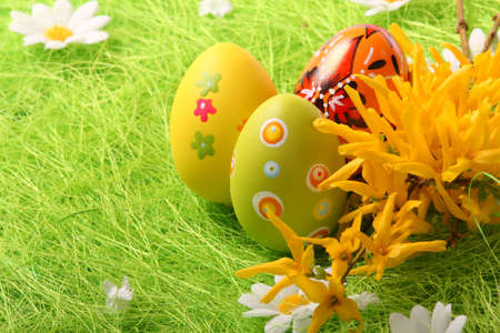 Easter Eggs sitting on grass field - close up Stock Photo - 6484374
