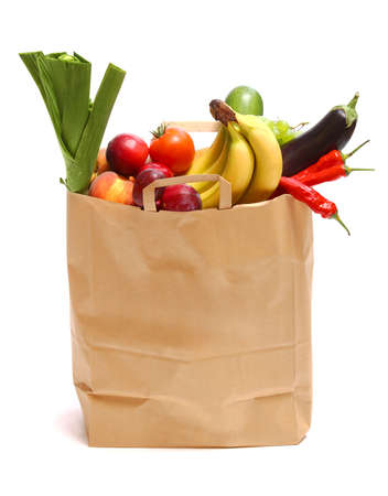 brown paper bags: A grocery bag full of healthy fruits and vegetables on white