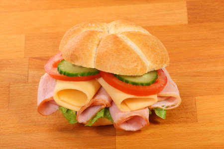 Delicious ham, cheese and salad sandwich, on a wooden board Stock Photo - 6851219
