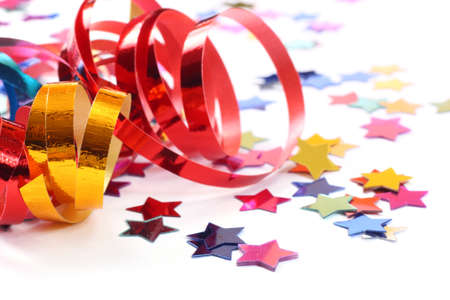 Stars in the form of confetti with streamers on white