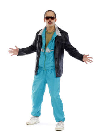Pimp, wearing a retro tracksuit and leather on white background photo