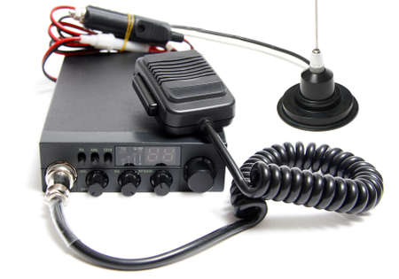 CB radio with microphone on white background