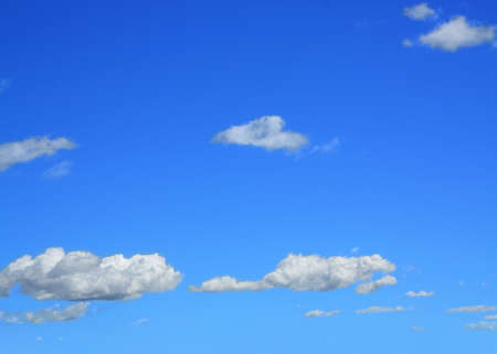 billowing: Beautiful billowing white clouds on blue sky